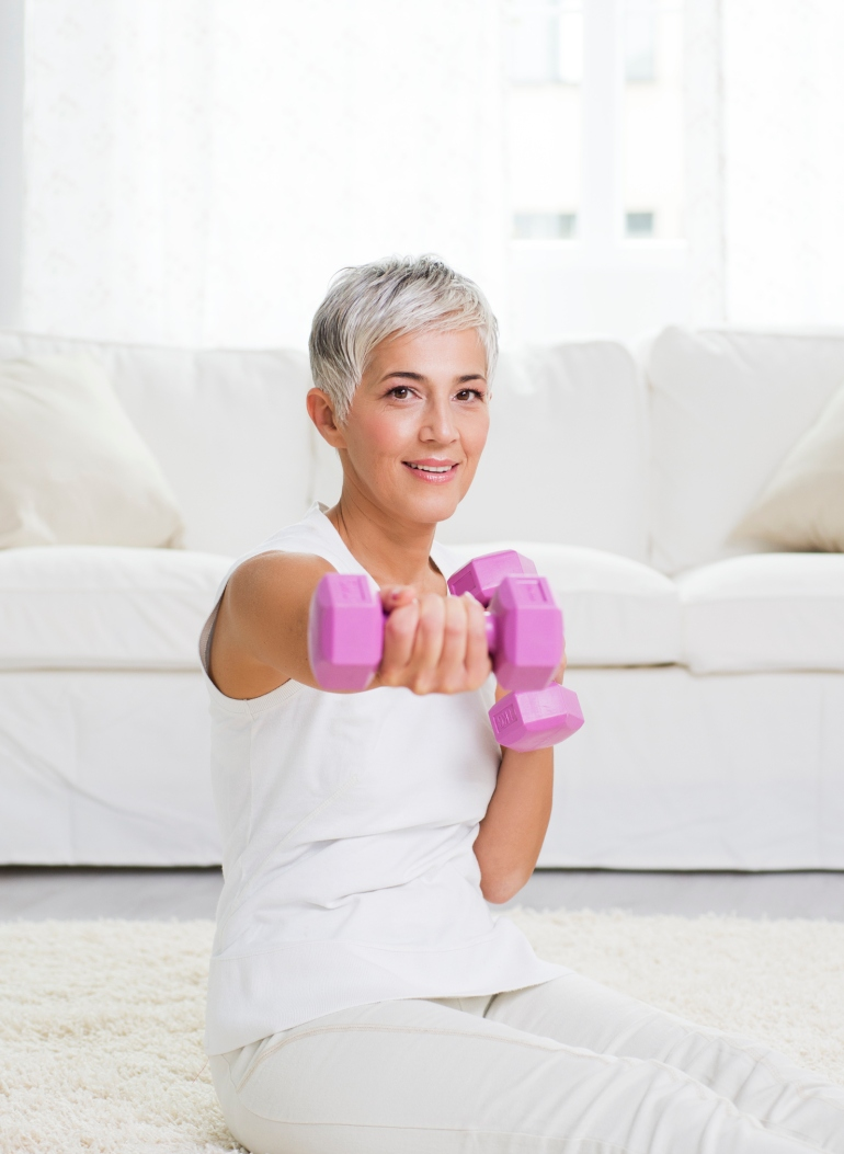 Mature woman exercising at home