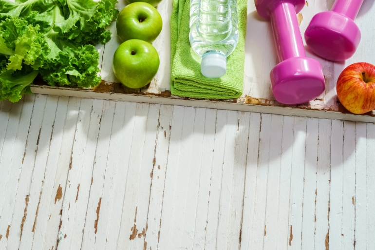 Fitness, healthy and active lifestyles Concept, dumbbells,  apples, vegetable